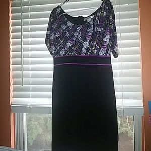 Black dress with multicolored top.